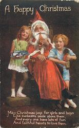 A HAPPY CHRISTMAS  seated Santa plays trumpet, boy & girl on each  side
