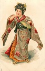 girl in kimono with fan in left hand, right index finger on her lip