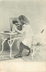 young girl in underclothes sits on chair looking in mirror on table left