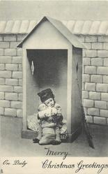 ON DUTY  child in uniform cuddles baby sitting in bottom of sentry box, gun at side