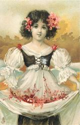 girl in white dress, black top,holds flowers in skirt, golden sky behind