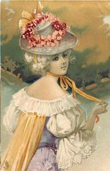 pretty girl in purple/white dress, red flowers on hat, looks over her shoulder, holding orange ribbon