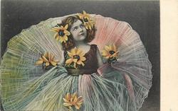 girl with enormous skirt has a sunflowers on her dress & in her hair, hands not visible, looks up