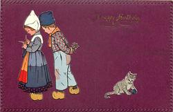 Dutch boy & girl walk left, she knits, he carries bouquet behind his back, kitten plays with wool