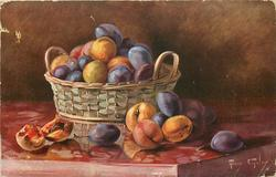 basket of plums and peaches, one on left with pit exposed