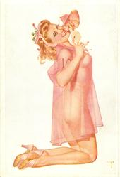 girl in light pink, kneels facing right