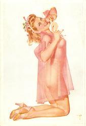 girl in light pink, kneels facing right