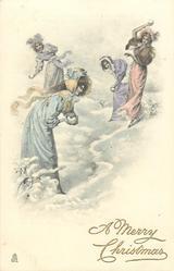 four young women snowballing