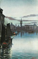 night scene, two boats with sails lower left