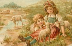 A HAPPY EASTER  two children sit with two lambs, ewe behind