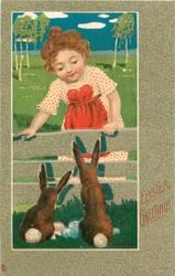 EASTER GREETINGS  girl looking over fence at two bunnies