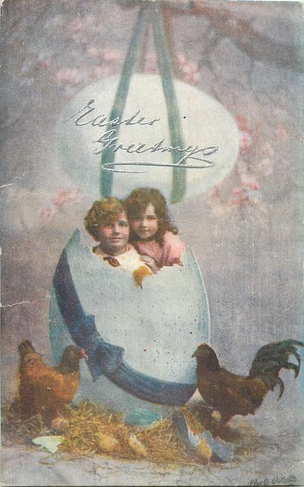 EASTER GREETINGS (in silver)  boy & girl in huge egg, another above, hens below, boy left