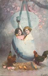 EASTER JOY  boy with arm raised & girl in huge egg, another above, hens below