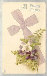 A HAPPY EASTER  bow of pale purple cloth makes cross, violets