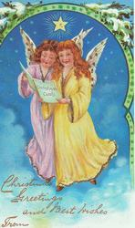 two angels, one in yellow, one in pink,read CHRISTMAS CAROLS, snow covered evergreen above