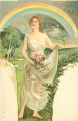 woman holds flowers in right hand, and dress in left