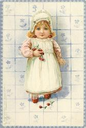 small girl in pink dress and white apron with cherries