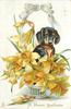 A HAPPY BIRTHDAY  dachshund sits behind bowl of daffodils, white bow above