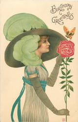 woman with enormous hat and green feathers, stylised rose, butterfly