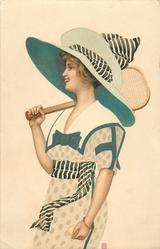 woman with enormous hat facing left with tennis raquet over right shoulfer