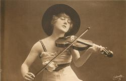 pretty girl in large hat plays violin, facing front & looking down at instrument