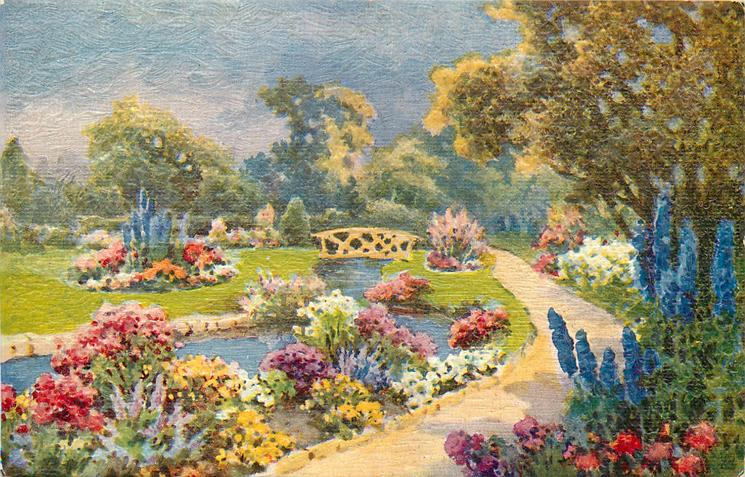 blue delphiniums & trees right of path to distant bridge, bed of flowers between path & water