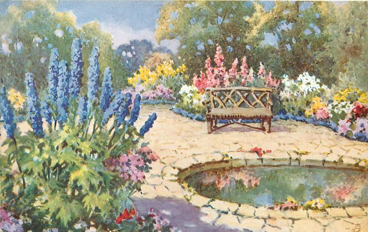 blue delphiniums to left, paving around pool in front of wooden seat, background of trees