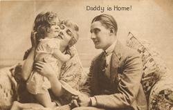 DADDY IS HOME  mother holds child, child has arms around mothers neck, father to right has hands folded on lap