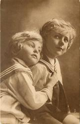 two blond children in sailor suits, child left rests head on other's shoulder & rests right arm/hand on the other child's chest