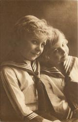 two blond children in sailor suits, both face right, child on right tilts head left
