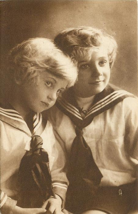 two blond children in sailor suits, child on left faces right & tilts head right, child on left faces slight left