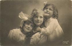 boy in sailor suit between two girls, girl on right has left hand on boys throat, no hands visible for girl on left, boy looks up