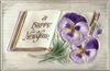 A HAPPY NEW YEAR  violet pansies lie on open book