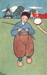 boy cutting stick, girl in background
