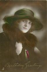 lady in brown coat with fur collar, she faces partly right, looks front