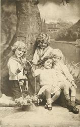 untitled: three boys & smaller girl sit posed with a fake tree, basket of flowers held at arms length by the girl and one boy