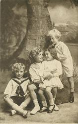 untitled: three boys & smaller girl sit posed with two boys to left, girl sits on boy's knee & looks into his eyes
