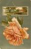 orange/yellow rose below oblong inset of country scene with tree to left, cottage to right & children in foreground