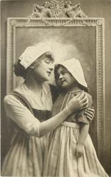 mother & child in Dutch costume stand in front of framed mirror, facing each other, mothers left hand on girls left arm, her right hand on girls left shoulder, girls left arm hangs down