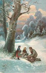 man kneeling to tie bundle of sticks, one girl sits on bench, another stands with hands in muff