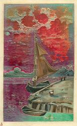 very shiny, metallic painted card with sailing boat & dingy tied up to warf, red sky & water