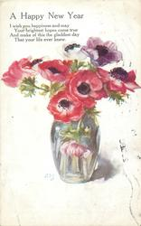 five red flowers, one purple & two white; one flower faces down in glass vase