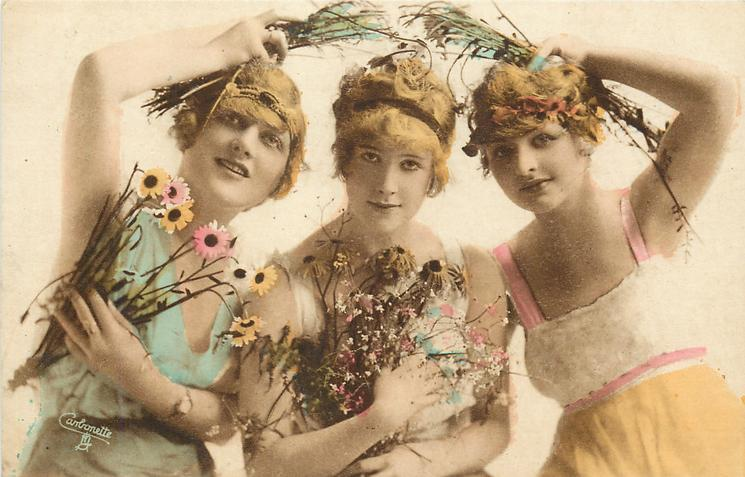 three girls carry flowers, centre girl faces & looks front, girls on either side hold flowers over her head