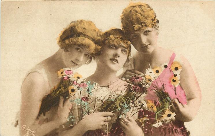 three pretty girls carry flowers, centre girl faces front & looks up, girl on left looks front, girl on right looks front, her left elbow tucked in, four hands visible