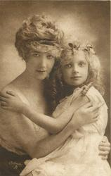 mother holds child in arms, mother to left, heads touch, girl's left hand on mother's right shoulder, mother's left hand on child's waist, mother's right hand just under childs left shoulder