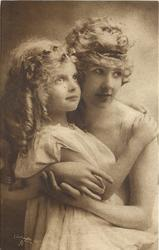 mother holds child in arms, mother to right, heads touch, girl's right hand on mother's left shoulder, mother's hands meet behind  girl, both look right