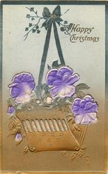MANY HAPPY RETURNS or A HAPPY CHRISTMAS  ribbon applique holding up basket of blue pansies