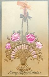 ribbon applique holds up basket of pink roses