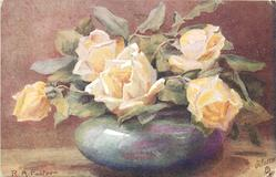 five yellow roses in light blue bowl