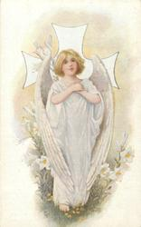 angel with folded arms, Easter lilies  behind